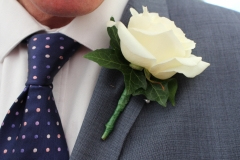 Traditional ivory rose buttonhole