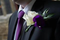Purple lizianthus and rose buttonhole