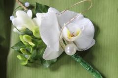 Flamboyant orchid buttonhole