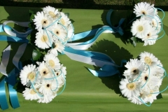 Turquoise bridesmaid bouquets with gerbera
