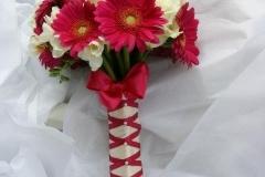 Vibrant pink gerbera and roses